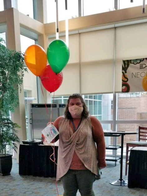 Becky Hill holding balloons